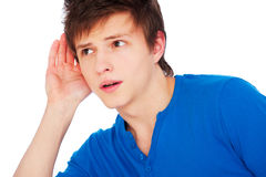 Young man listening gossip Royalty Free Stock Images