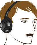 Young man listening music. Stock Images