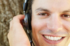 Young man listening music Stock Images