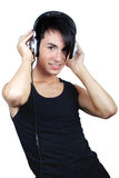 Young man listening music Stock Image
