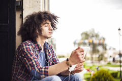 Young man listening music with digital tablet. Young man listening music with the digital tablet Stock Photography
