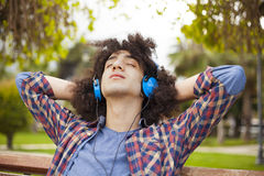 Young man listening music with earphones Stock Photo