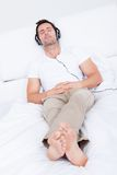 Young man listening music on headphone Stock Photo