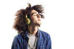 Young man listening music with headphones Stock Photography