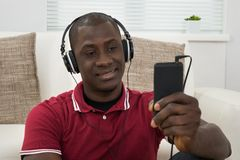 Young Man Listening Music On Headphones Royalty Free Stock Photo