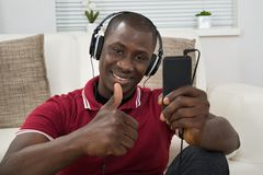 Young Man Listening Music On Headphones Royalty Free Stock Photos