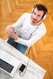 Young man listening music on his Laptop Royalty Free Stock Photo