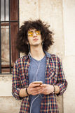 Young man listening music with mobile phone Royalty Free Stock Images