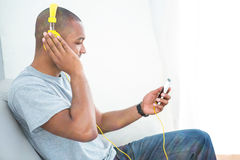 Young man listening music on smartphone Stock Photography
