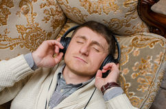 Young man is listening music Stock Photography
