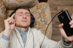 Young man is listening music Royalty Free Stock Image