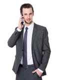 Young man listening on a phone Stock Photos