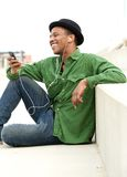 Young man listening to call on mobile phone Royalty Free Stock Photos
