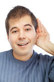 Young man listening to gossip Stock Images
