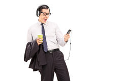 Young man listening to his favorite songs on phone. Isolated on white background stock image