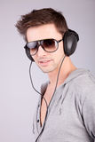 Young man listening to music Royalty Free Stock Images