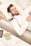 Young man listening to music Stock Images