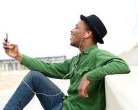 Young man listening to music on cellphone Royalty Free Stock Images