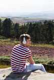 Young Man Listening To Music In Countryside On Headphones Stock Photography