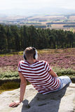 Young Man Listening To Music In Countryside On Headphones Royalty Free Stock Images
