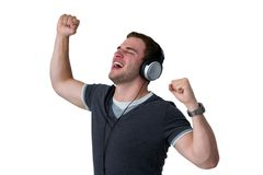 Young Man Listening to music and dancing. With arms in air Royalty Free Stock Photo