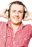 Young man listening to music through earphones Royalty Free Stock Photography