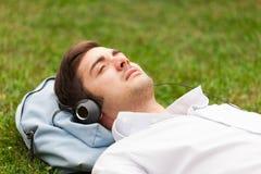 Young man listening to music. Man enjoying good music outdoor Stock Photo