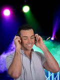 Young Man Listening to Music at Event Royalty Free Stock Photo