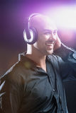 Young man listening to music Stock Image