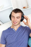 Young man listening to music with headphones Stock Photography