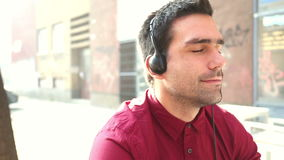 Young man listening to music with headphones stock footage