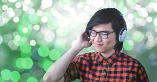 Young man listening to music on headphones. Digital composite of Young man listening to music on headphones Royalty Free Stock Photos