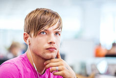 Young man listening to music with headphones Royalty Free Stock Photos