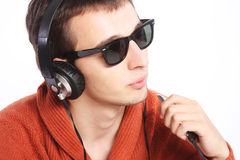 Young man listening to music on his headphones Stock Photography