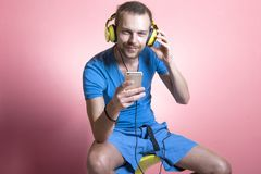 Young man listening to music on his mobile phone royalty free stock photo