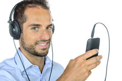 Young man listening to music with his phone Stock Images