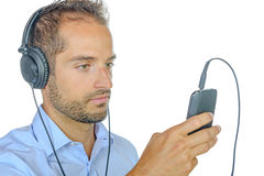 Young man listening to music with his phone Royalty Free Stock Photo