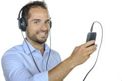 Young man listening to music with his phone Stock Photography