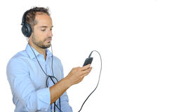 Young man listening to music with his phone Royalty Free Stock Photography