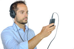 Young man listening to music with his phone Stock Photo