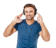 Young man listening to music Stock Photography