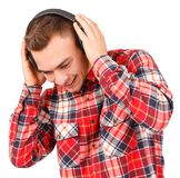 Young man listening to music isolated on white background Stock Photography