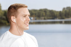 Young man listening to music outdoors Royalty Free Stock Photo