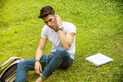 Young Man Listening to Music in Park Stock Photography