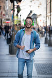 Young man listening to music on a smart phone.Enjoying the rhyth Royalty Free Stock Photo