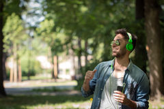 Young man listening to music on a smart phone.Enjoying the rhyth Stock Image