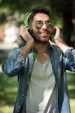 Young man listening to music on a smart phone.Enjoying the rhyth Royalty Free Stock Photography
