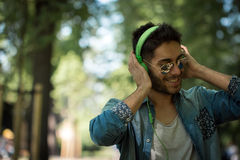 Young man listening to music on a smart phone.Enjoying the rhyth Stock Images