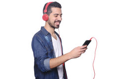 Young man listening to music with smartphone. Royalty Free Stock Image