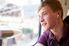 Young Man Listening To Music On Train Journey Royalty Free Stock Photos